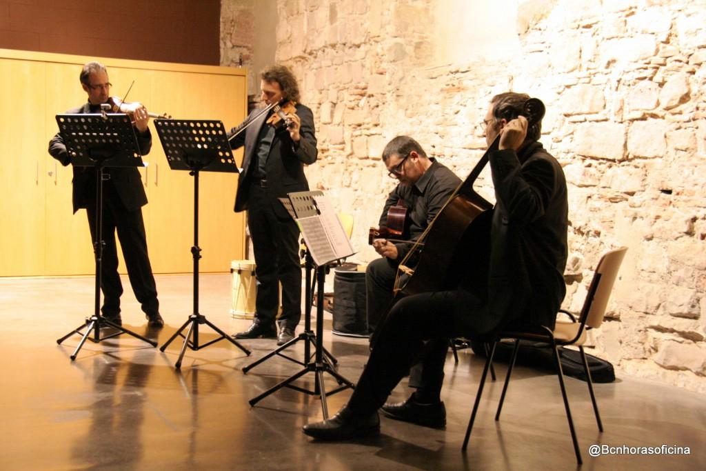Cuarteto de cuerda en plena actuación